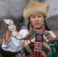 Lhamo, one of the characters of Tibet In Song explaining the costume which her grandmother sent from Tibet